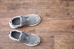 Sportive male shoes. On wooden floor Royalty Free Stock Image
