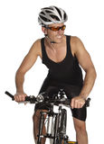 Sportive man on a bike Royalty Free Stock Photo