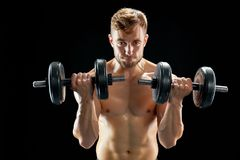Sportive man doing bicep curls royalty free stock images
