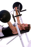 Sportive man doing Weightlifting with barbell. Man lying on bench and doing weightlifting with barbells. Isolated on white background Stock Image