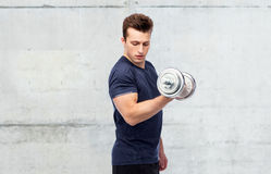 Sportive man flexing muscles with dumbbell Stock Photography