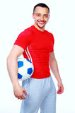 Sportive man holding soccer ball Royalty Free Stock Images