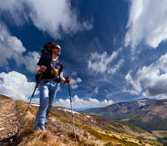 Sportive man on mountain trek Royalty Free Stock Images