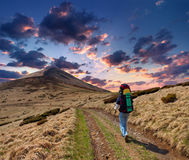 Sportive man on mountain trek Stock Images