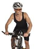 Sportive man på en cykel Royaltyfri Foto
