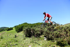 Sportive man riding mountain bike Stock Photos