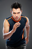 Sportive man running Stock Image
