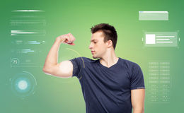 Sportive man showing bicep power Royalty Free Stock Photo
