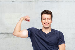 Sportive man showing bicep power Stock Photography