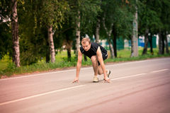 Sportive man in starting position prepared to run Royalty Free Stock Photography
