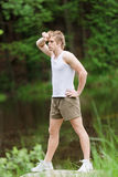 Sportive man stretching after training in nature Stock Images