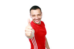 Sportive man thumbing up in red T-shirt Stock Images
