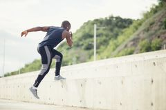 Sportive man training - Runner jogging, healthy lifestyle and sport concept. Sportive man training outdoors - Runner jogging, healthy lifestyle and sport concept Royalty Free Stock Images