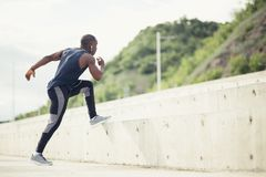 Sportive man training outdoors - Runner jogging, lifestyle and sport concept Royalty Free Stock Photo