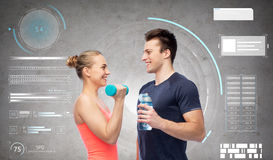Sportive man and woman with dumbbell and water Royalty Free Stock Photos