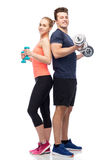 Sportive man and woman with dumbbells Royalty Free Stock Photography