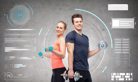 Sportive man and woman with dumbbells Royalty Free Stock Photo
