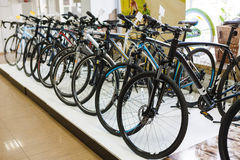 Sportive mountain bike row in the store Stock Photos