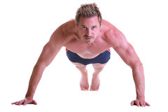 Sportive muscular man doing Push-up workout Stock Photos
