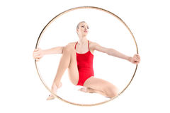 Sportive rhythmic gymnast holding hoop in hands. Isolated on white Stock Photography