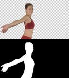 Sportive sprawności fizycznej sportsmenki rozciągania ręki i śmiać się, Alfa kanał obraz stock