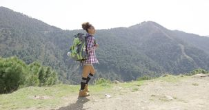 Sportive woman with backpack in mountains stock video footage