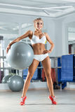 Sportive woman with ball in the gym Royalty Free Stock Photography