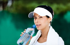 Sportive woman with bottle of water Royalty Free Stock Image
