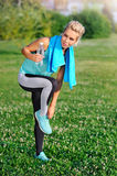 Sportive woman cheking her shoes Royalty Free Stock Photo