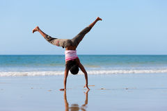 Sportive woman doing gymnastics on the beach Royalty Free Stock Image