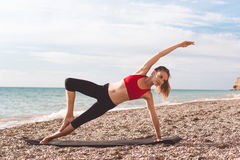 Sportive woman doing sports on the beach Stock Photo