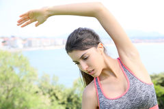 Sportive woman doing stretching by the seaside Stock Images