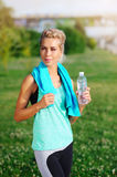 Sportive woman drinking water after workout Stock Photo