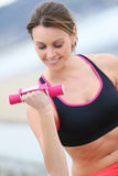 Sportive woman excercising Stock Images