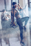 Sportive woman exercising with trx gym equipment Royalty Free Stock Photography