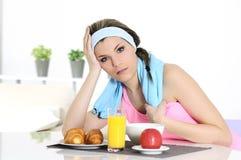 Sportive woman having breakfast Royalty Free Stock Photo