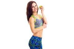 Sportive woman holding apple Stock Image