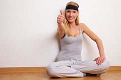 Sportive woman holding thumb up Stock Photos