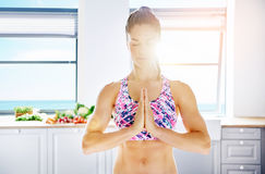 Sportive woman keeping hands together in meditation Royalty Free Stock Images