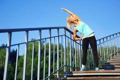 Sportive woman making morning exercises Royalty Free Stock Image