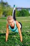 Sportive woman making plank exercise Royalty Free Stock Image