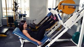 Sportive woman making sport at gym Stock Images