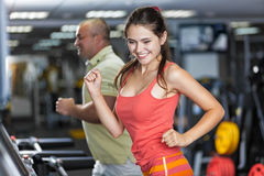 Sportive woman and man are jogging treadmill Stock Images