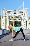 Sportive woman practicing Triangle yoga Pose Royalty Free Stock Images
