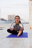 Sportive woman practicing yoga Royalty Free Stock Image