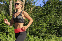 A sportive woman. While running Stock Photography
