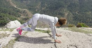 Sportive woman stretching body stock footage