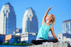 sportive woman stretching her muscles before yoga practice Royalty Free Stock Photos