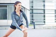 Sportive woman stretching before jogging Stock Photography