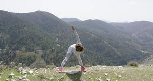 Sportive woman stretching on nature stock video footage